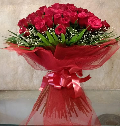 Flowers Delivery in CalcuttaBouquet of 50 Red Rose in Net Packing