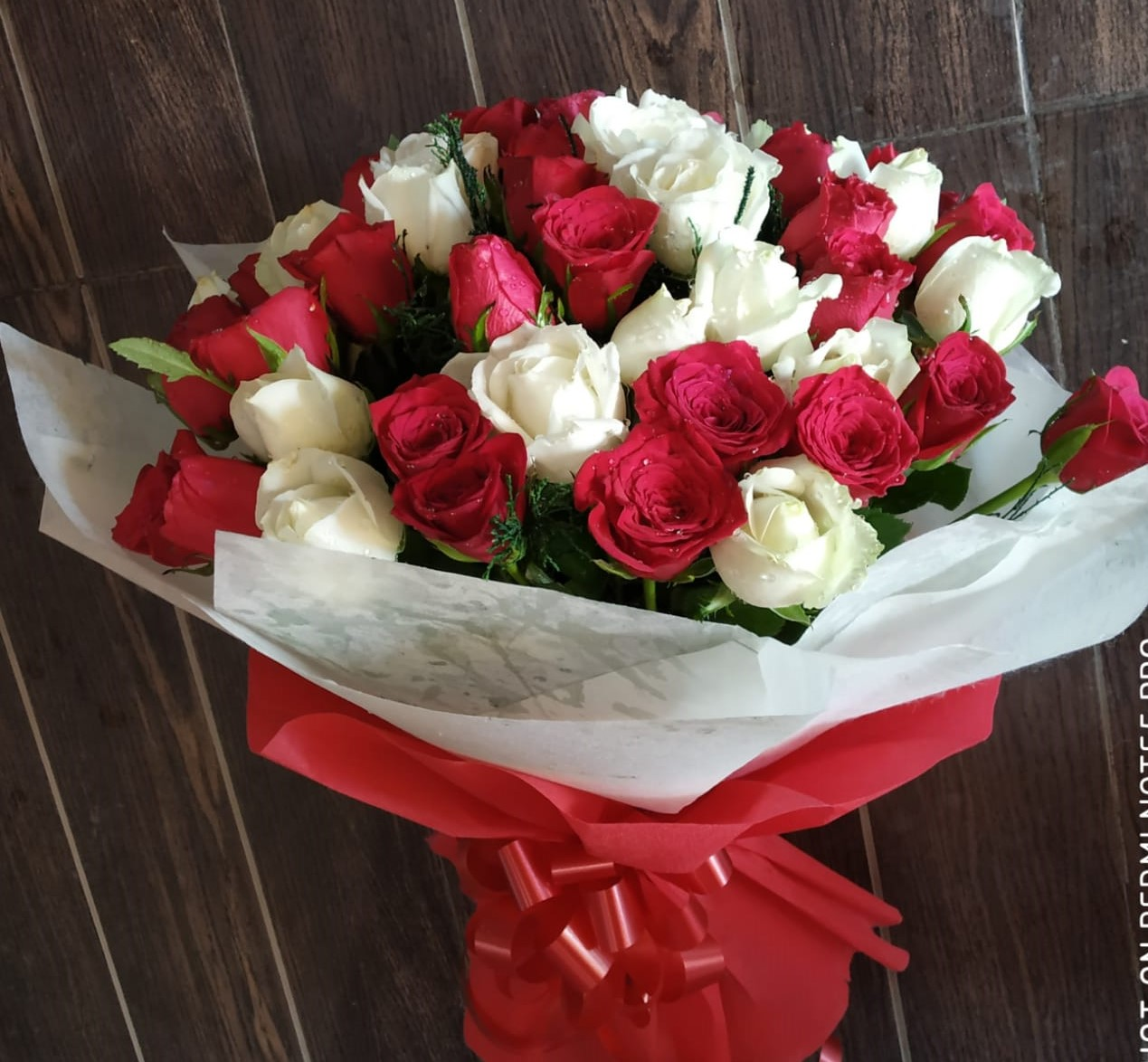 Flowers Delivery in CalcuttaRed & White Roses in Duble Layer Packing