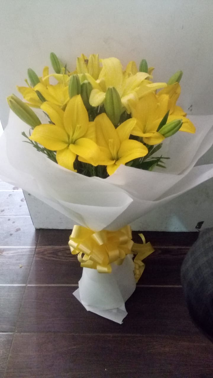 Yellow Asiatic Lilliums in White Paper
