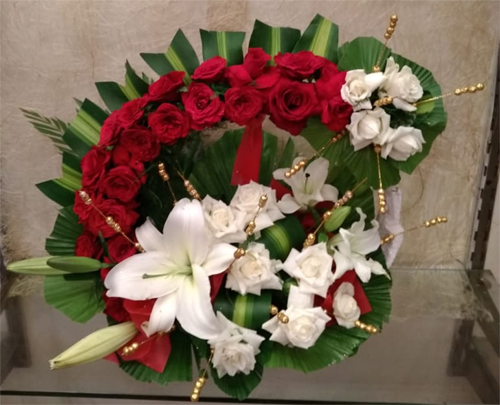 Arrangement of Roses & Lillys