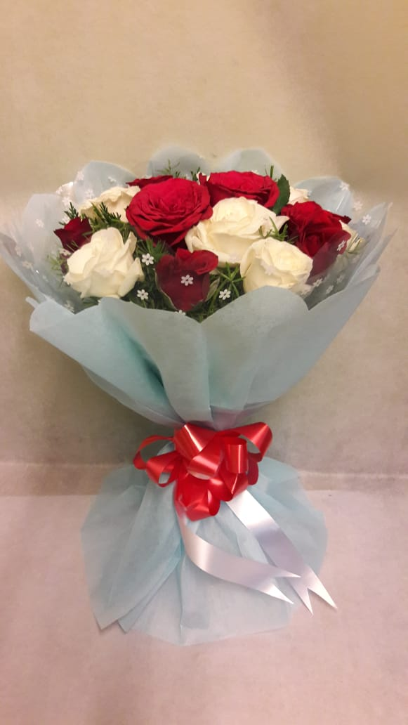 Red & White Roses in Blue Paper