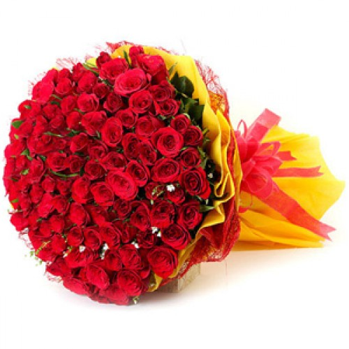 Flowers Delivery in GwaliorBunch of 100 Red Roses in Yellow Paper Packing