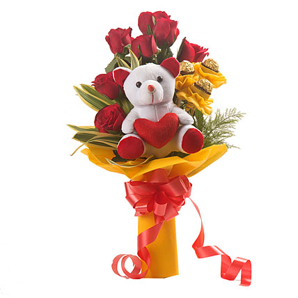 Flowers Delivery in MeerutRed Roses & Ferrero Rocher & Tedddy Bunch