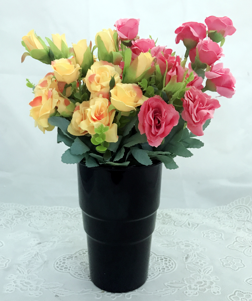 Pink & Yellow Mini Roses in a Black Plastic Vase (Only For Delhi)