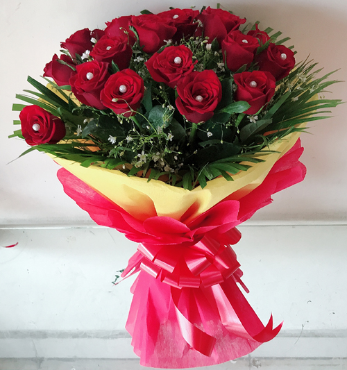 Flowers Delivery in JalandharBunch of 30 Red Rose in Red & Yellow Paper Packing