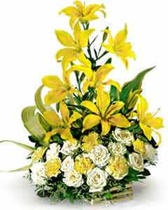 Lillium and Roses arranged in a Basket