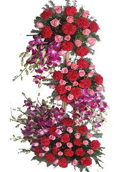 Three Tier Arrangement of mix exotic flowersdelivery in Patna
